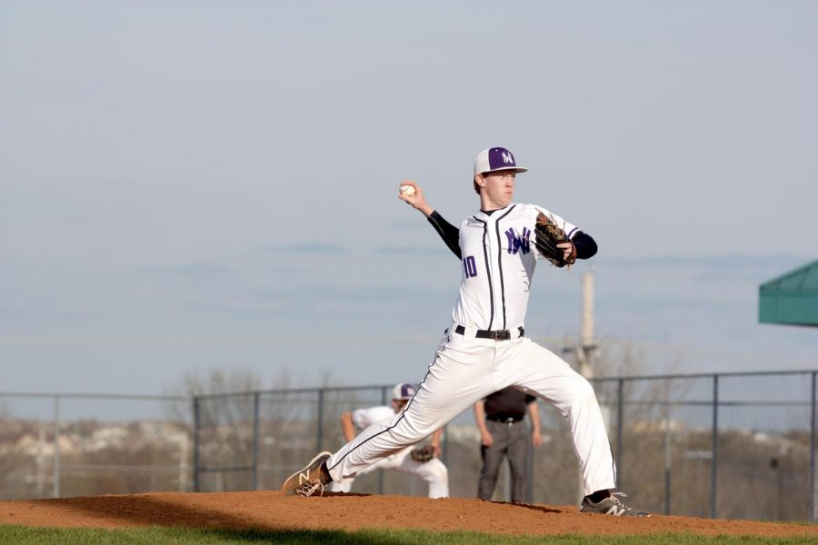 Junior+David+Kephart+throws+a+pitch+during+the+seventh+inning+of+the+Huskies+matchup+with+Blue+Valley+North+April+26.+The+Huskies+defeated+the+Mustangs%2C+12-3.+