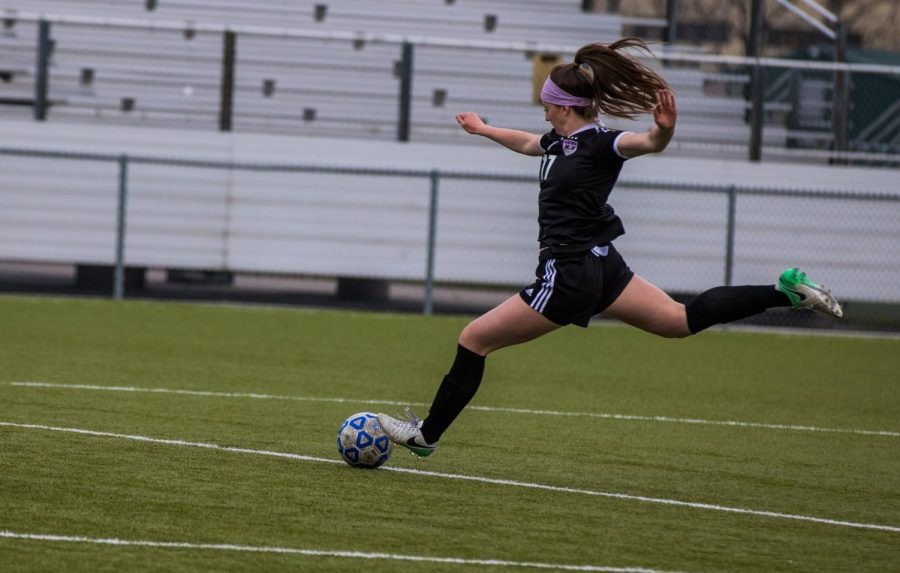 Senior Shay Pemberton (17) prepares to kick the ball during the Huskies matchup with Olathe South Friday April 20. The Huskies lost to the Falcons, 3-2.