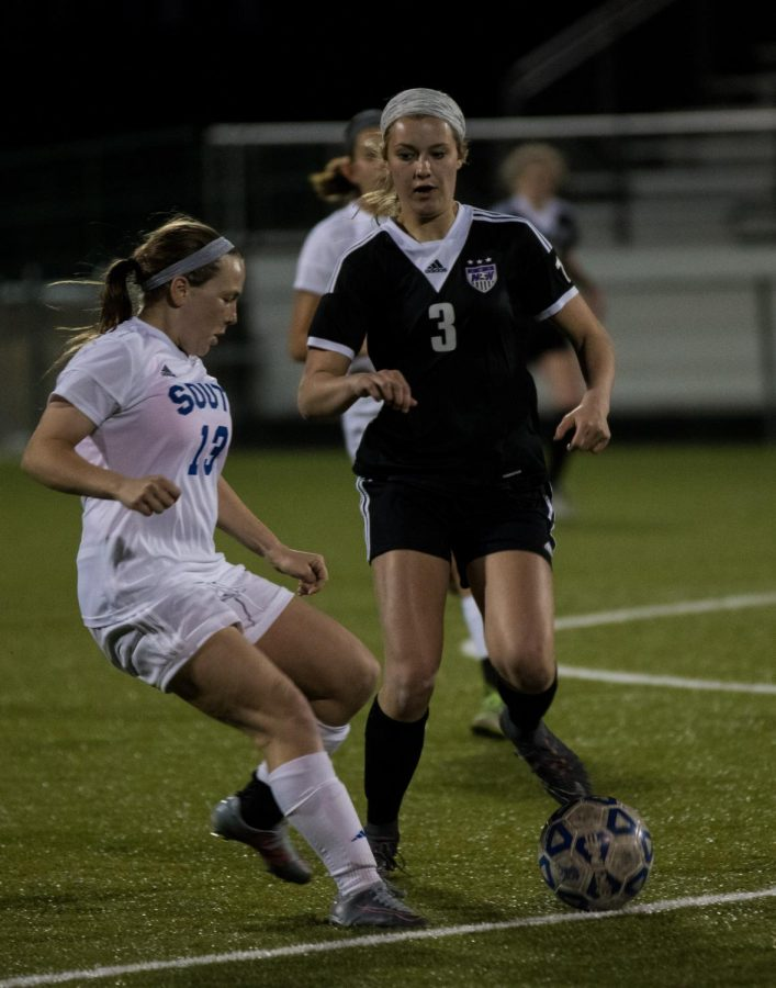 Junior Grace Coble (3) goes for the ball against an Olathe South player. The Huskies lost to the Falcons, 3-2.