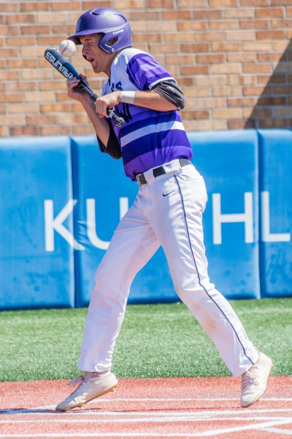 Senior Jack Beckley gets hit by a pitch in the top of the fifth inning of the Huskies matchup with Blue Valley at Hoglund Ballpark May 26. The Tigers defeated the Huskies, 1-0.