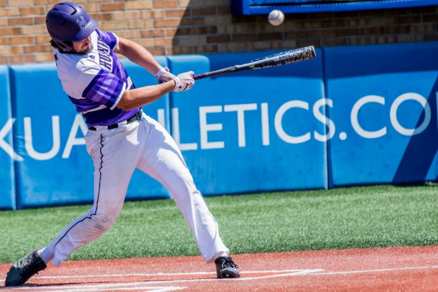 Senior Josh Fiene swings at a pitch during the Huskies matchup with Blue Valley at Hoglund Ballpark May 26. The Tigers defeated the Huskies, 1-0.