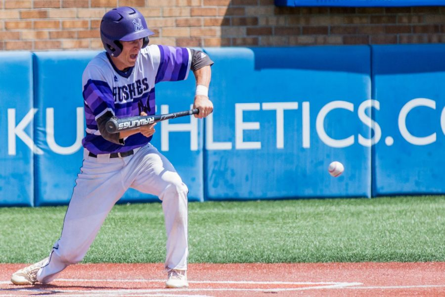 Senior Jack Beckley bunts the ball during the seventh inning of the Huskies matchup with Blue Valley at Hoglund Ballpark May 26. The Tigers defeated the Huskies, 1-0.