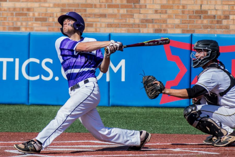 Junior Ryan Freiermuth flys out to left field with the bases loaded in the top of the first inning of the Huskies matchup with Blue Valley at Hoglund Ballpark May 26. The Tigers defeated the Huskies, 1-0.