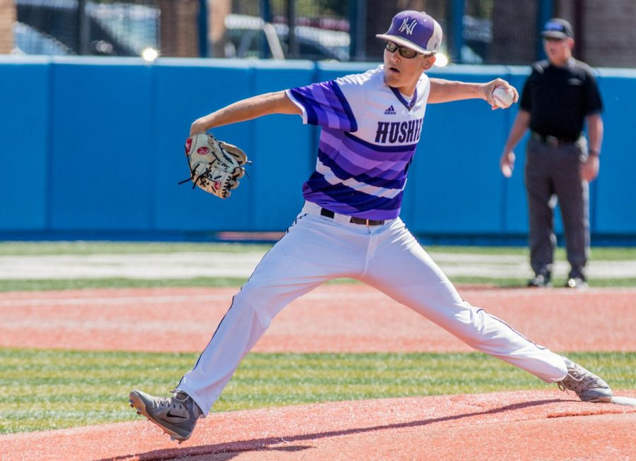 Senior Scott Duensing throws a pitch during the Huskies matchup with Blue Valley at Hoglund Ballpark May 26. The Tigers defeated the Huskies, 1-0.