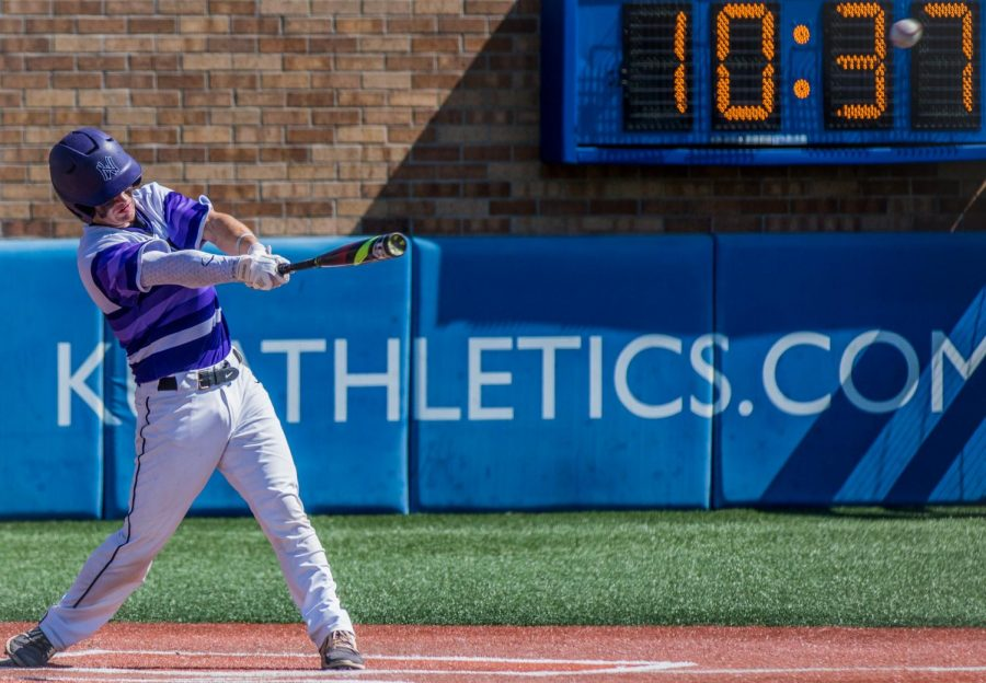 Senior Clayton Leathers swings and misses at a pitch for one of his three strikeouts of the day during the Huskies matchup with Blue Valley at Hoglund Ballpark May 26. The Tigers defeated the Huskies, 1-0.