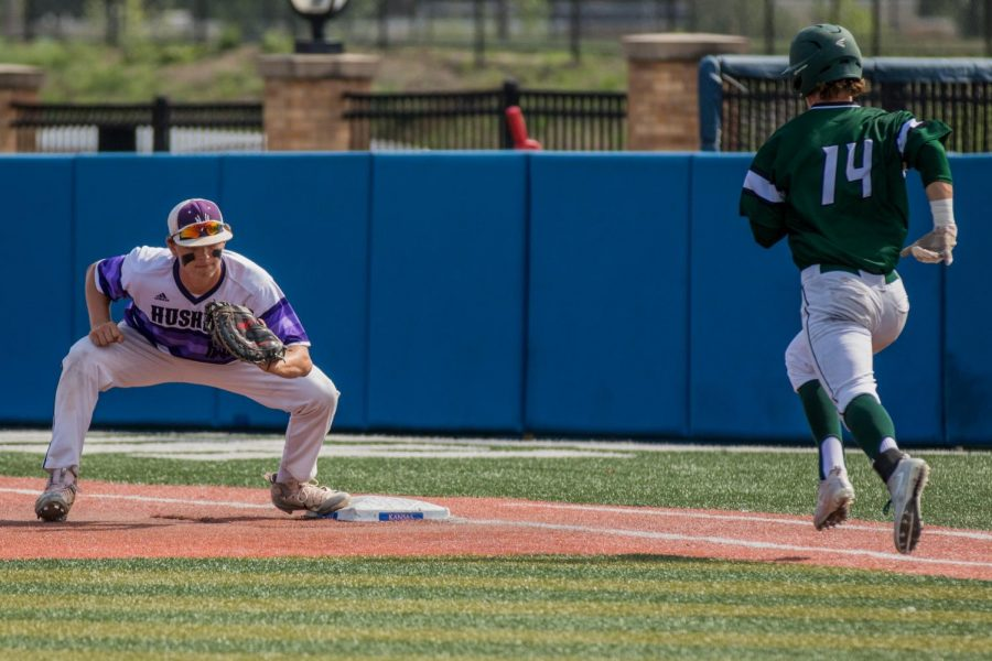 Senior Holden Missey catches the ball to complete a strikeout during the top of the third inning of the Huskies matchup with Derby at Hoglund Ballpark May 25. The Huskies defeated the Panthers, 4-3.