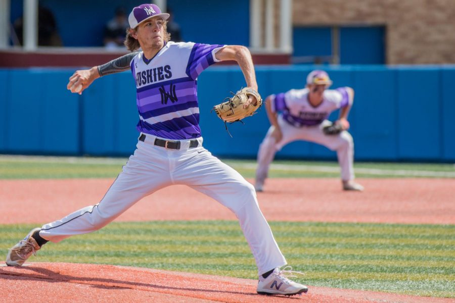 Senior Max Abramovich throws a pitch during the Huskies matchup with Derby at Hoglund Ballpark May 25. The Huskies defeated the Panthers, 4-3.