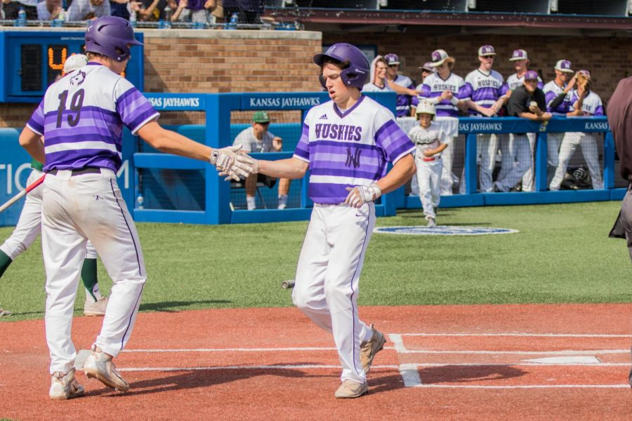 Senior Jack MacGee scores the game-tying second run of the game in the bottom of the third inning of the Huskies matchup with Derby at Hoglund Ballpark May 25. The Huskies defeated the Panthers, 4-3.