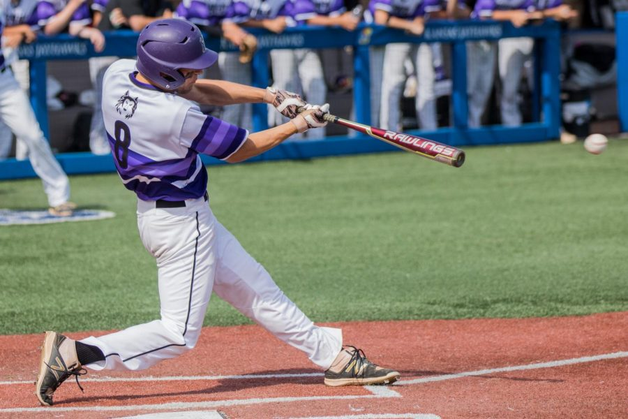 Junior Ryan Freiermuth connects with a pitch during the bottom of the third inning of the Huskies matchup with Derby at Hoglund Ballpark May 25. The Huskies defeated the Panthers, 4-3.