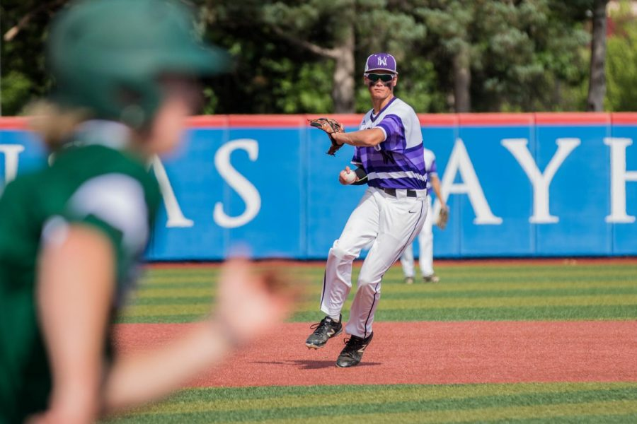 Sophomore Ryan Callahan fields a ground ball during the Huskies matchup with Derby at Hoglund Ballpark May 25. The Huskies defeated the Panthers, 4-3.