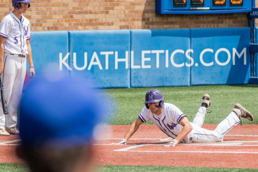 Junior Ryan Freiermuth slides into home plate during a four-run fourth inning of the Huskies matchup with Washburn Rural at Hoglund Ballpark May 24. The Huskies defeated the Blues, 9-3.