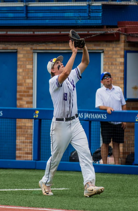 Senior Holden Missey catches a popout in foul territory during the seventh inning of the Huskies matchup with Washburn Rural at Hoglund Ballpark May 24. The Huskies defeated the Blues, 9-3.