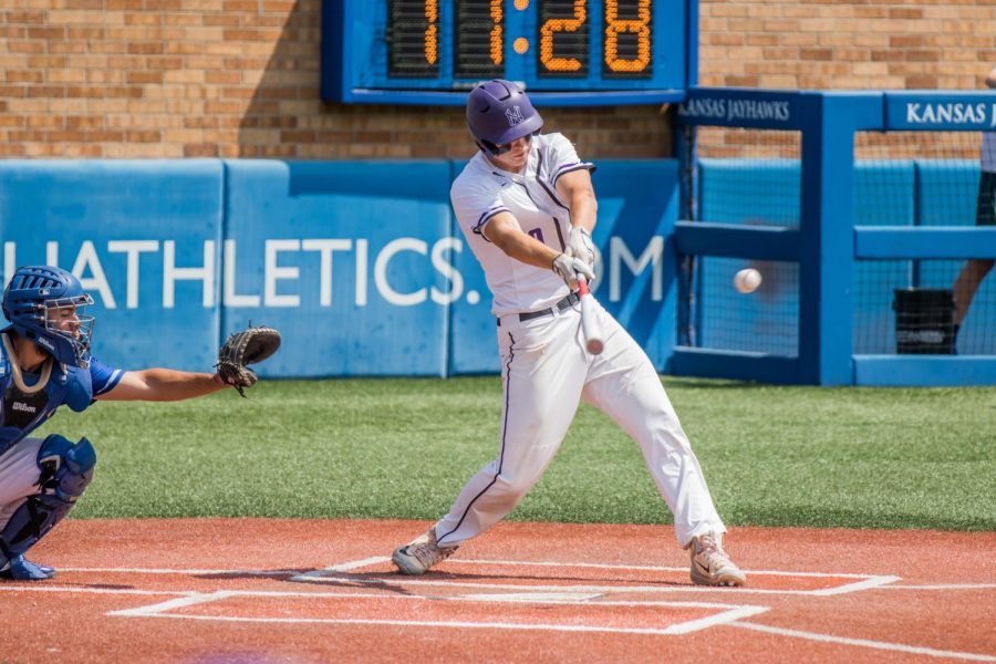 Senior Holden Missey makes contact for a single during the Huskies matchup with Washburn Rural at Hoglund Ballpark May 24. The Huskies defeated the Blues, 9-3.