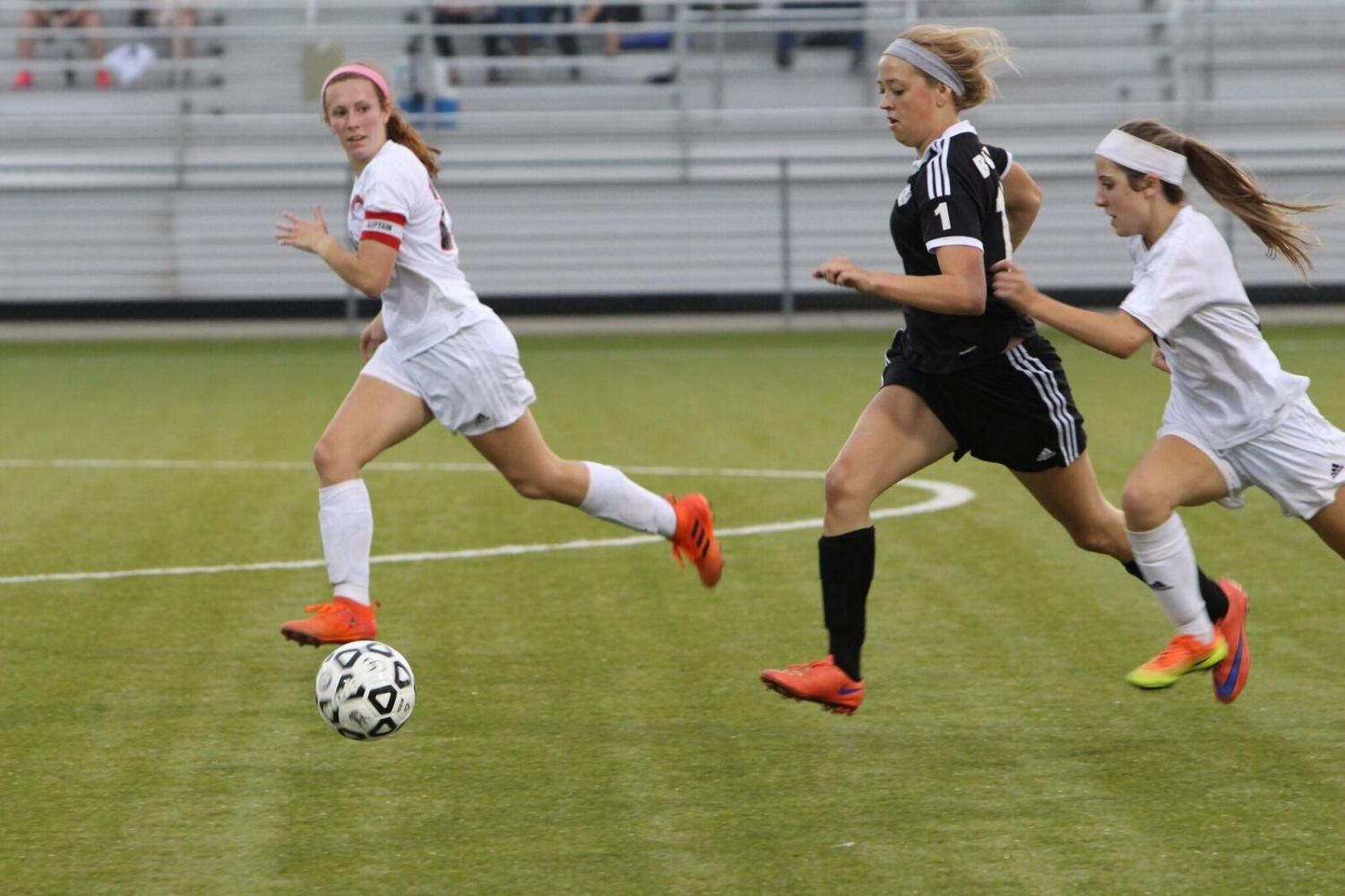 Senior Grace Fugate dribbled up the field Monday, May 14 in the first game of regionals.