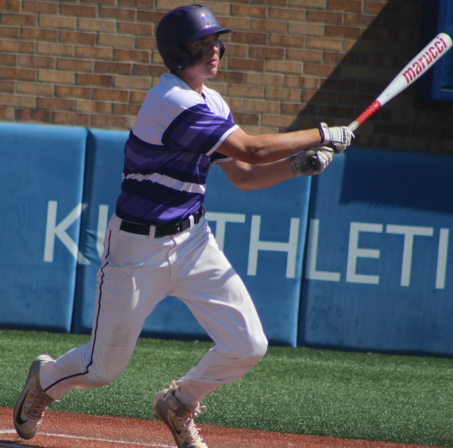 Senior first baseman Holden Missey watches as he hits a triple against Blue Valley High School at Hoglund Ballpark May 26. The Huskies were defeated by the Tigers 1-0 to finish second at the state tournament.