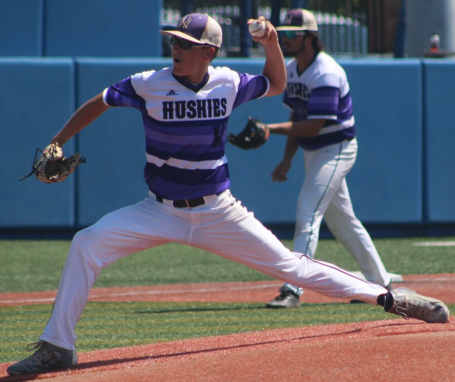 Senior pitcher Scott Duensing delivers a pitch against Blue Valley High School at Hoglund Ballpark May 26. The Huskies were defeated by the Tigers 1-0 to finish second at the state tournament. Duensing pitched six innings allowing one run on six hits.