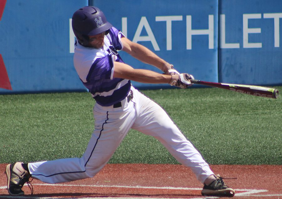 Junior left fielder Ryan Friermuth swings his bat against Blue Valley High School at Hoglund Ballpark May 26. The Huskies were defeated by the Tigers 1-0 to finish second at the state tournament.