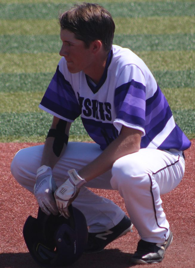 Sophomore center fielder Matt Miller drops to the ground after the final out against Blue Valley High School at Hoglund Ballpark May 26. The Huskies were defeated by the Tigers 1-0 to finish second at the state tournament.