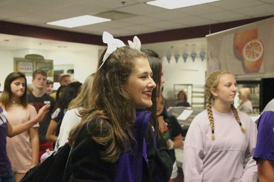 Freshman Marlee Volmer smiles while in the cafeteria.