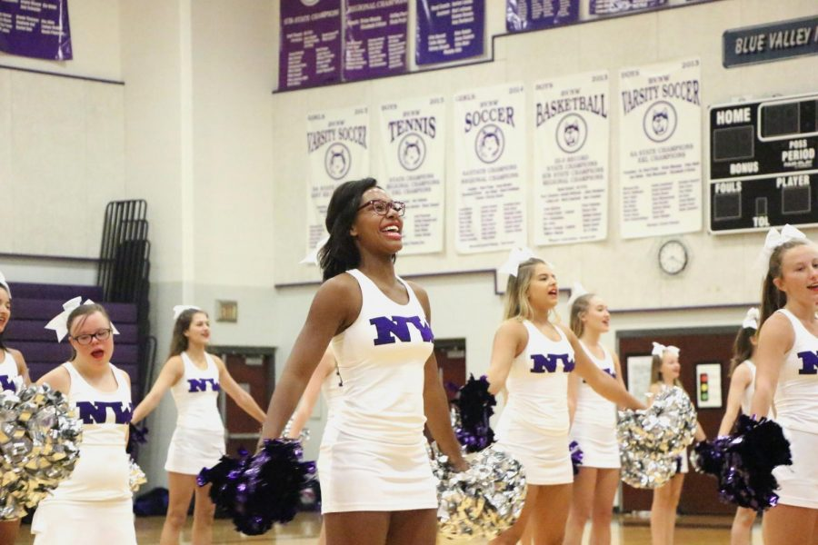 Junior Jordan Nevels performs with the cheer squad during the freshman orientation assembly.
