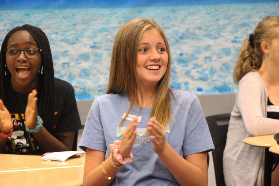 Freshman Ella Buffington claps in Erin Pearsons Honors English Language Arts class during freshman orientation.