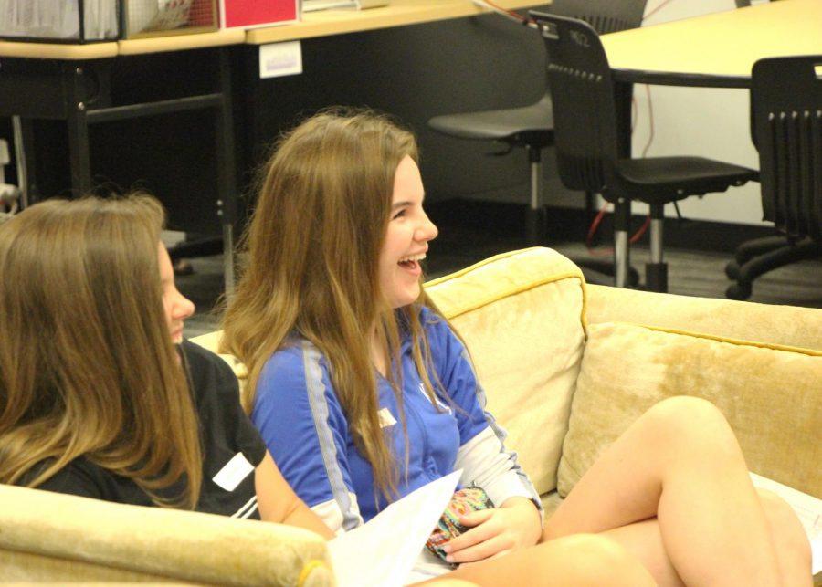 Freshman Maggie Bunch laughs during journalism teacher Jim McCrossens 21st century journalism class.