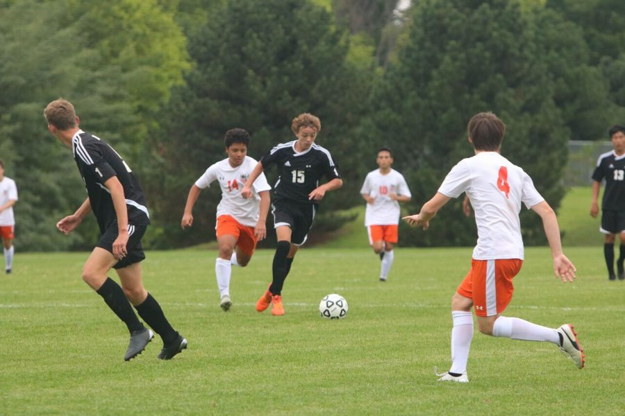 Sophomore Christian Colle dribbles up the field against Shawnee Mission Northwest on Aug. 29 at the Blue Valley West sub-varsity fields. BVNW defeated SMNW, 3-1.
