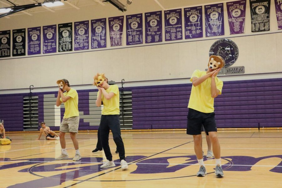 Juniors Matthew Easum, Taylor Carter and Jake Dolesh perform during the junior skit on Jungle Day Monday Sept. 24.