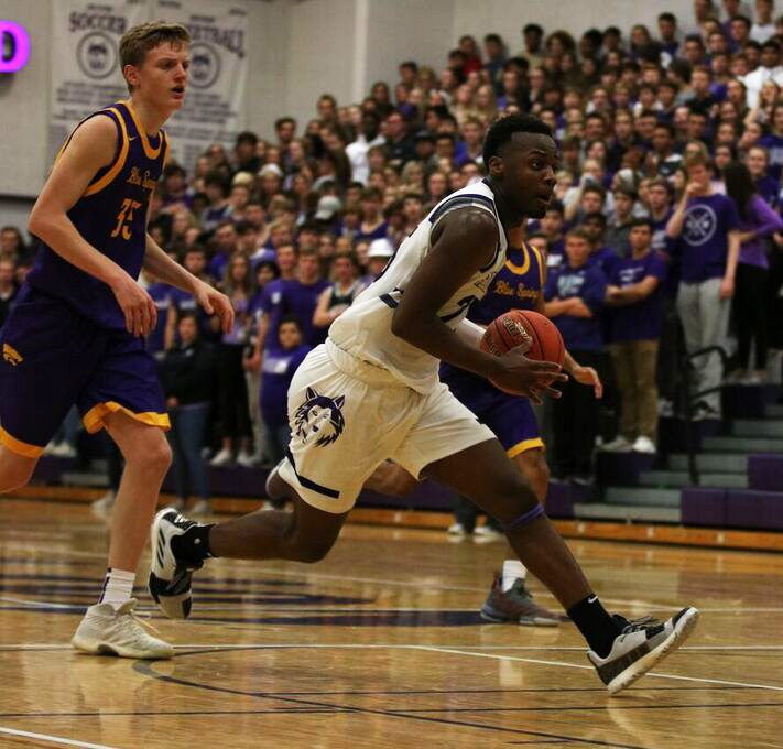 Senior Markell Hood carries toward the basket during the game against Blue Springs, Nov. 30. BVNW defeated BSHS, 70-40.