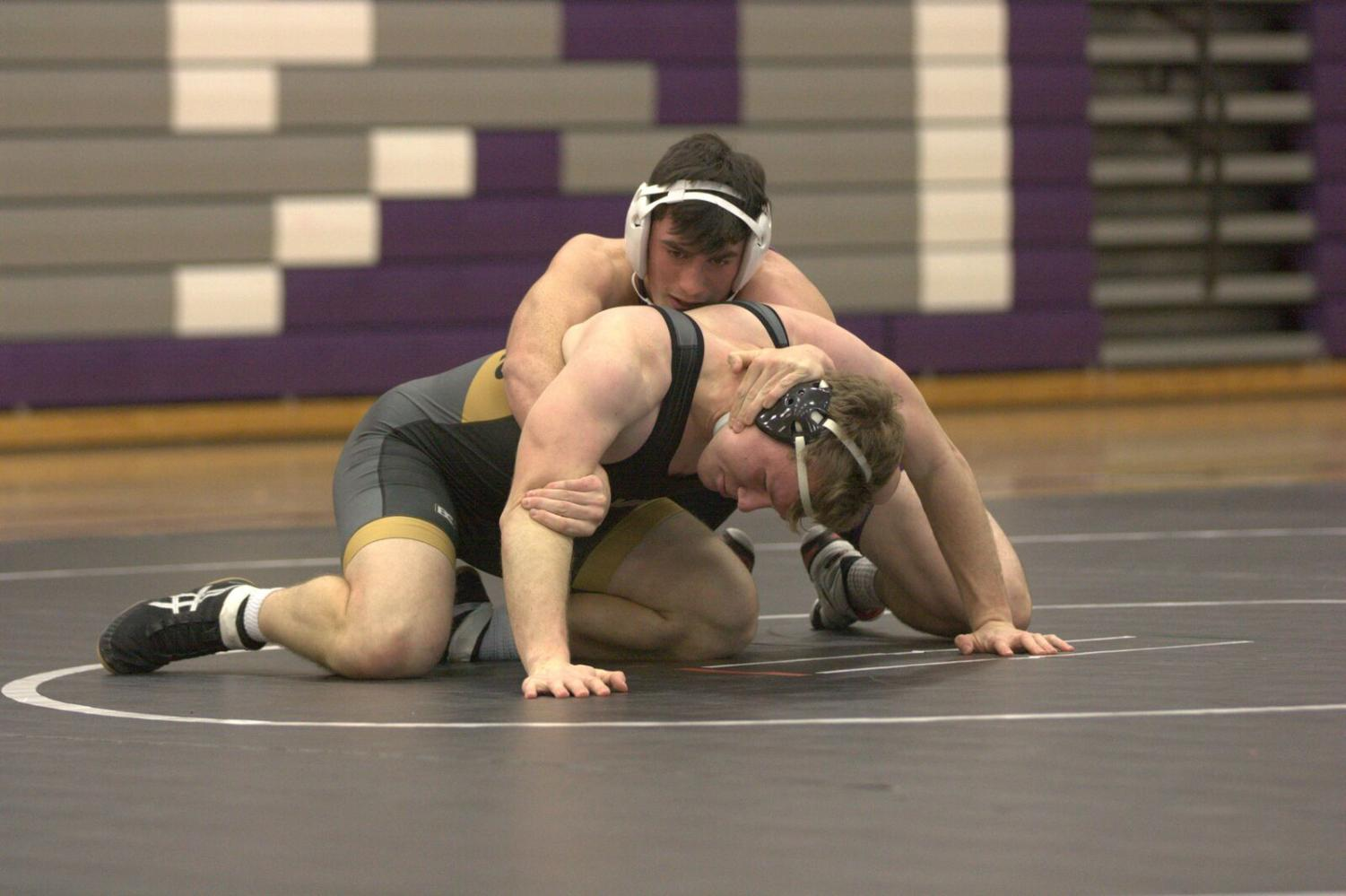 Sophomore Caiden Casella wrestles in a meet on Dec. 13 at Blue Valley.