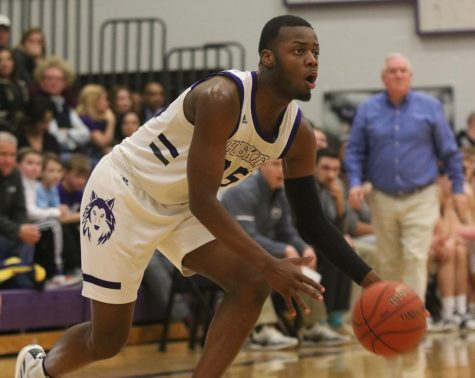 Senior move in Markell Hood dribbles the ball in the game against Blue Valley on senior night on Feb. 14 at BVNW. The win improved the Huskies record to 17-2.