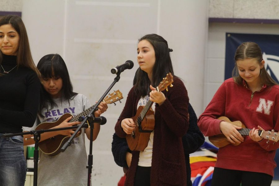 Sophomore Natalie Detmer performs with the ukuele club during the assembly Friday March 1.