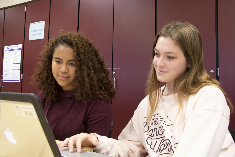 Junior Emily Lanning peer tutors junior Leisha Williams in her history class.