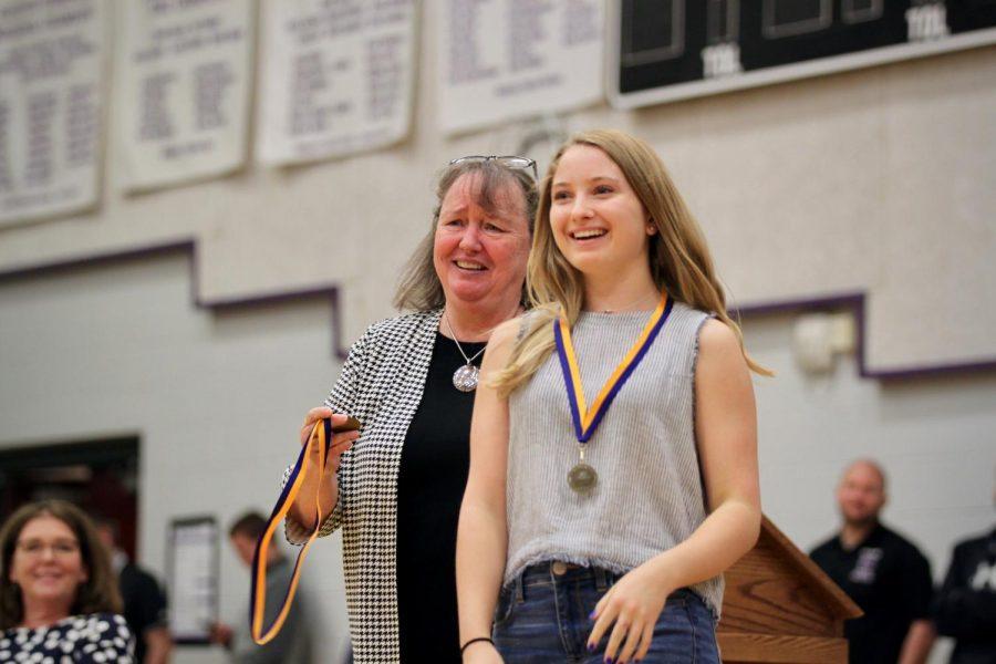 Junior Sarah Kriet receives medal for her Sunflower Award essay nominating spanish teacher Kari Hillen.