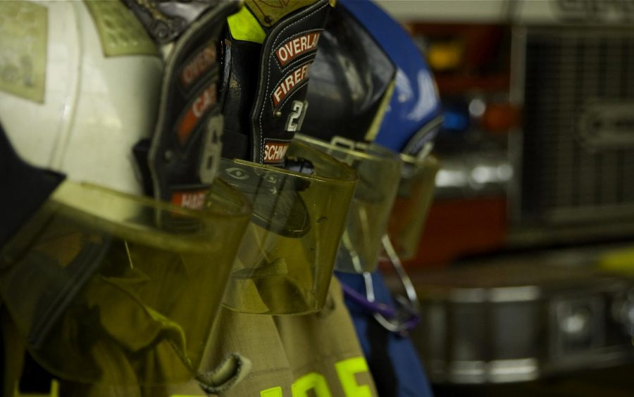 Helmets+worn+by+firefighters+hang+in+a+locker+room.+