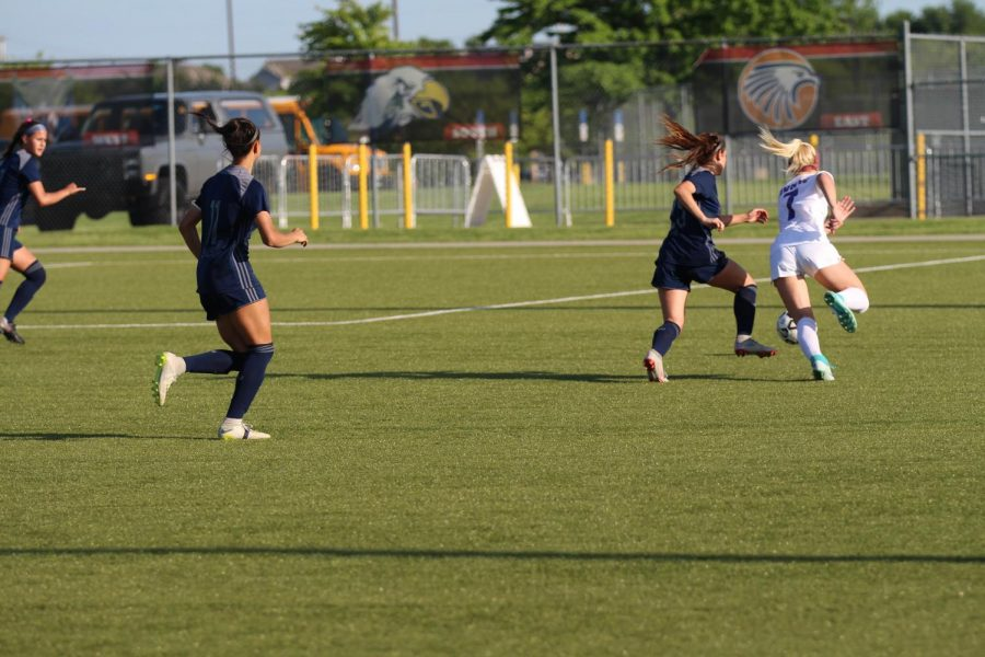 Sophomore Mary Hungerford sprints down the field towards the goal in game against Olathe West. The Huskies defeated the Owls, 2-1.