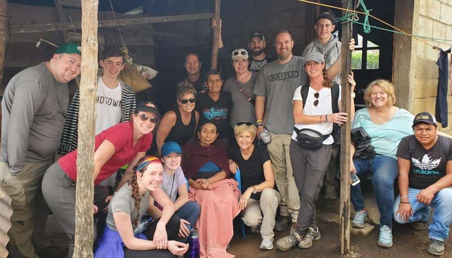Juniors+CJ+and+Ella+Lyon+stand+next+to+a+stroke+survivor+and+her+husband%2C+who+they+helped+construct+a+bathroom+and+running+water+for.