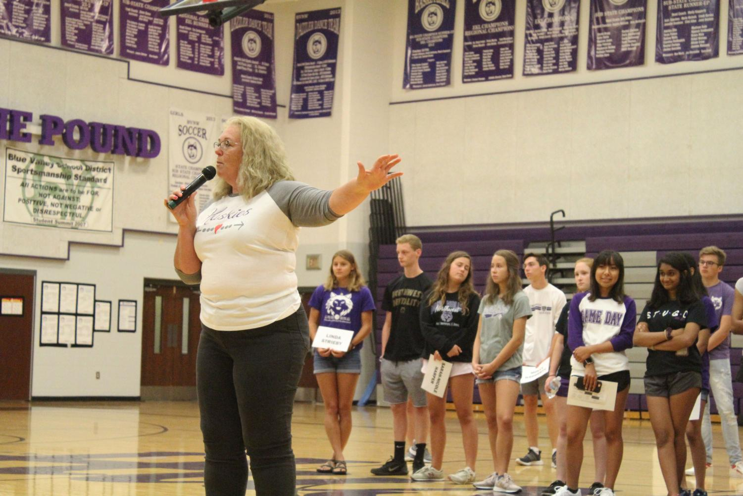 Principal+Amy+Pressly+speaks+to+the+freshman+class+during+freshman+orientation+on+Aug.+14.+