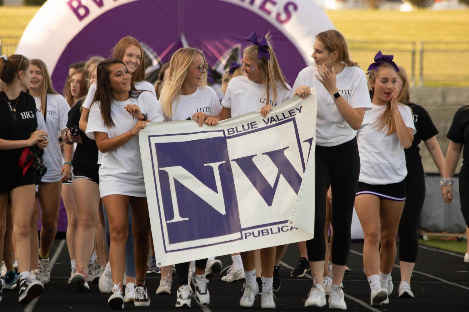 BVNW+Yearbook+staff+walks+through+the+tunnel+and+across+the+track+during+the+Husky+Night+parade%2C+on+Aug.+30.+