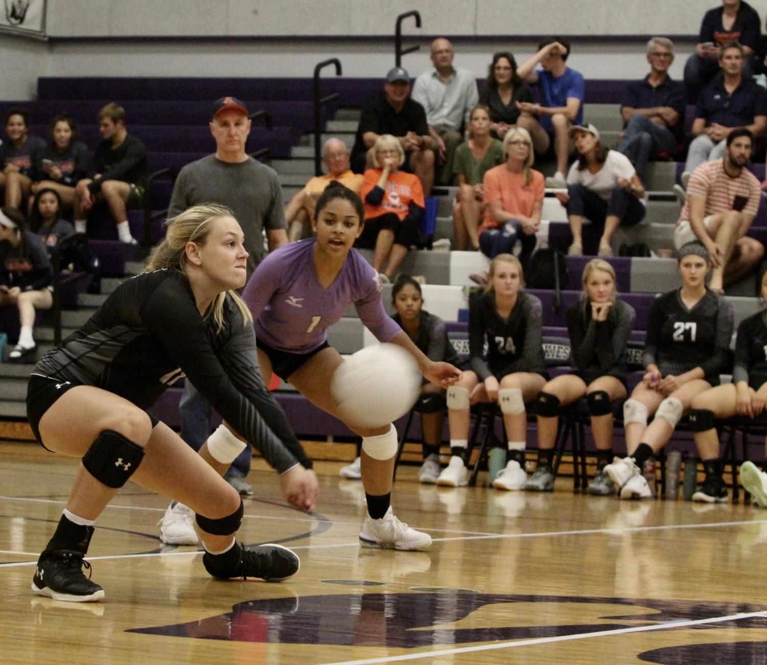 Junior Delany Granholm digs the ball in a volleyball game for Blue Valley Northwest. BVNW defeated BVN, 3 sets to 1.
