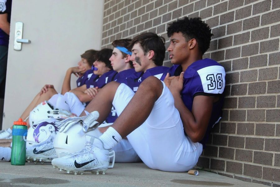 Blue Valley Northwest football players sit together prior to the game against Blue Valley Southwest on Friday Sept. 27 at the DAC. BVNW fell to BVSW, 27-28.