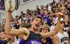 Graduated senior John Fischbach cheers during the homecoming assembly, on Oct. 11, 2019.