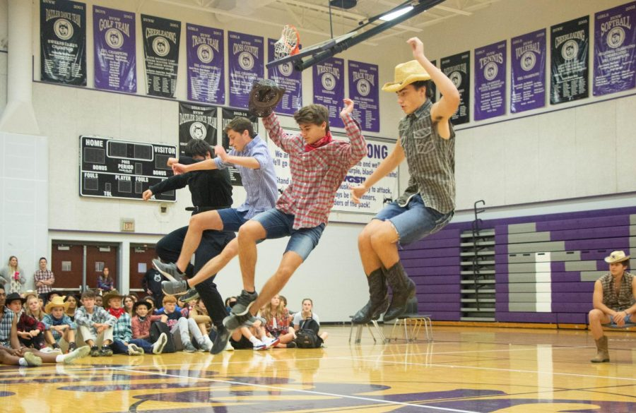 Seniors Danny Robinson, Luke Blau, Jackson Million and Jay Oakes jump together in the senior skit, on Oct. 8.