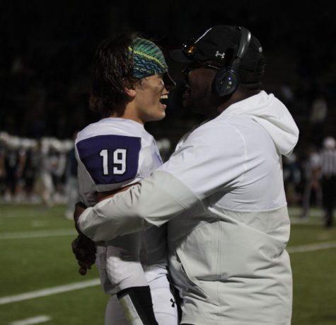 Senior receiver Evan Ranallo hugs coach David Faggett after beating BVN, on Oct. 18.