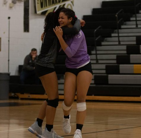 Senior Meiko Pearson hugs sister Alayna Pearson after losing final game of season to Blue Valley, 2-0.