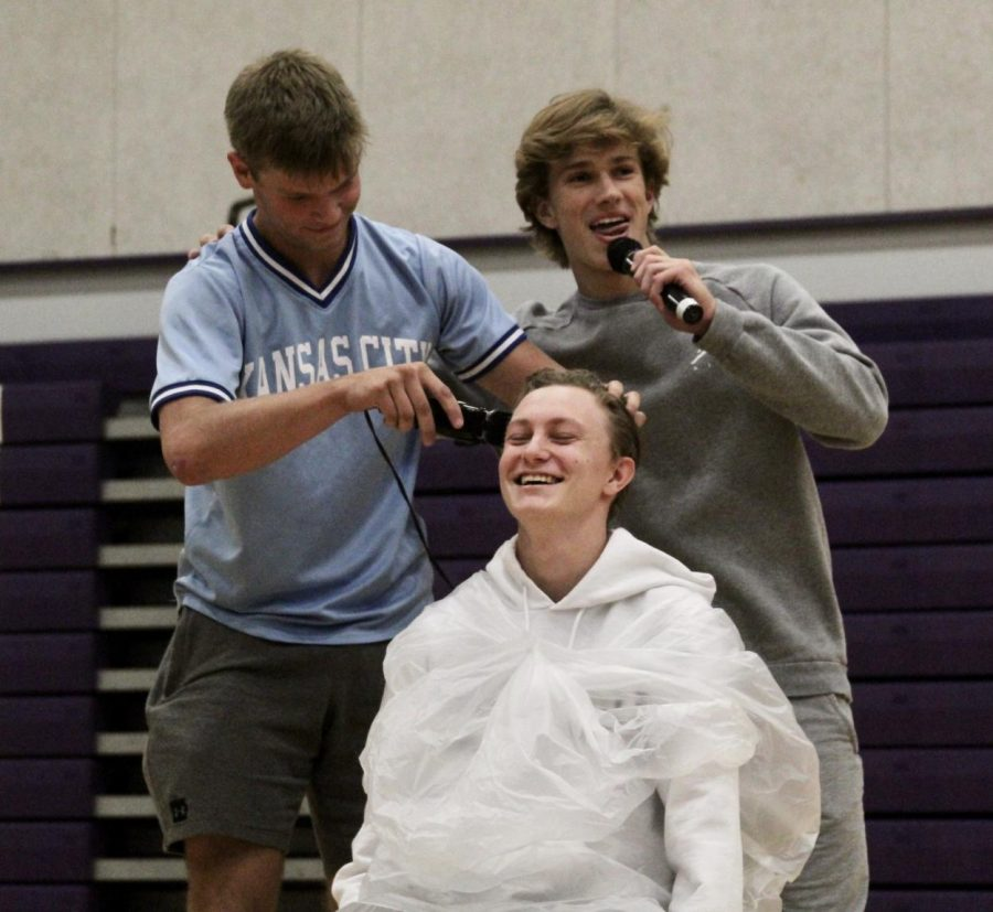 Seniors Ryan Callahan and Jake Dolesh shave senior Ben Barron's hair into a mullet during the senior spirit skit, on Oct. 9.