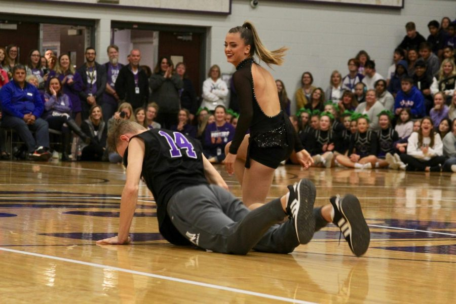Seniors Ben Barron and Bella Steketee dance into the gym for homecoming royalty, on Oct. 11.