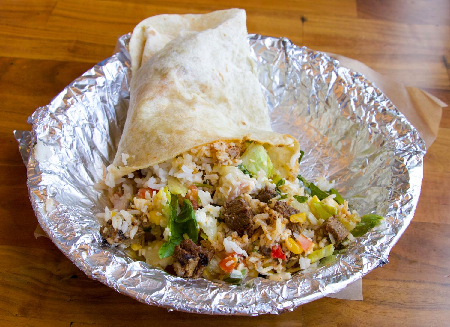 A make your own burrito sits in an aluminum tray at Qdoba on 135th and Metcalf.