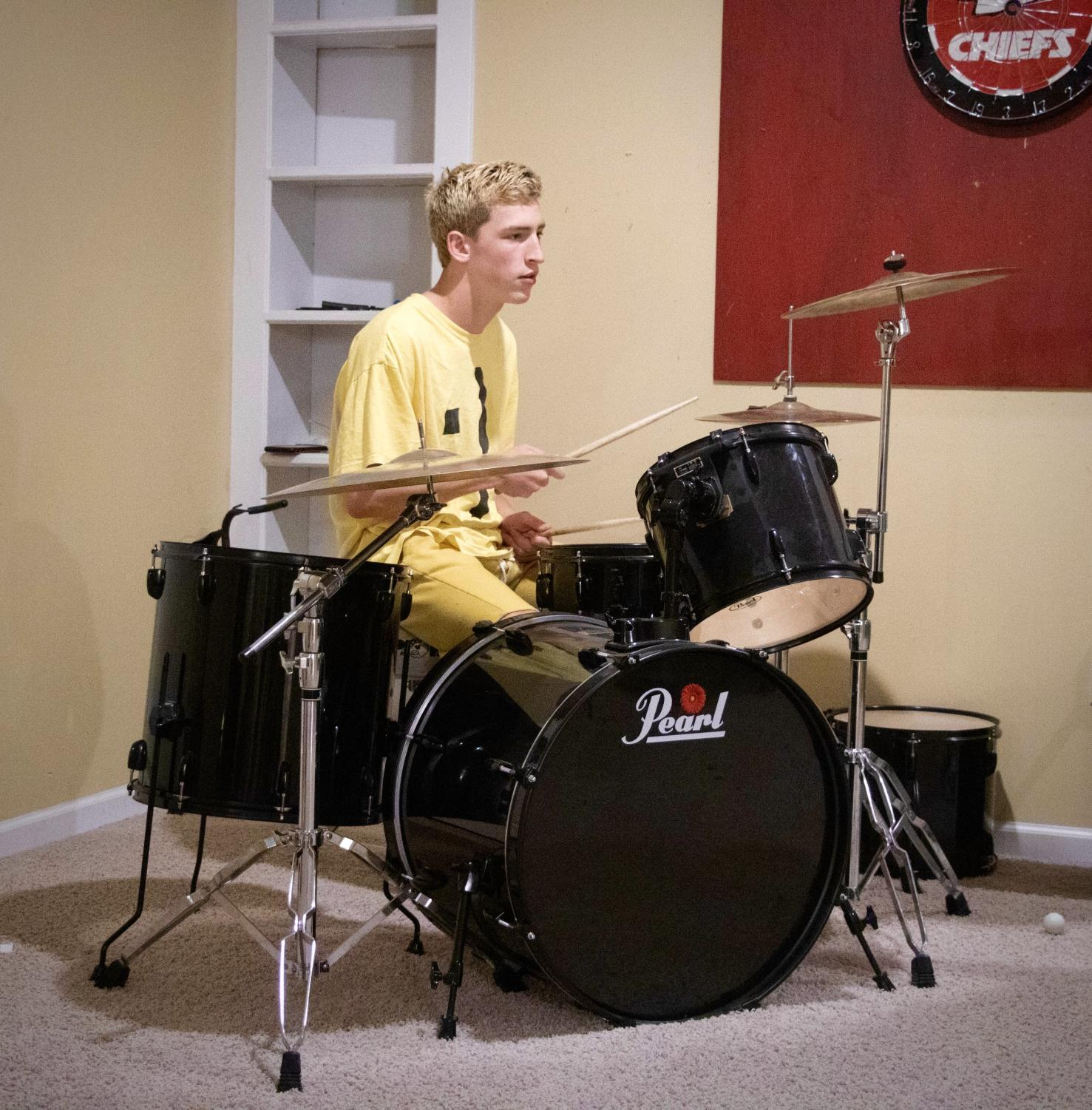 Senior Watchman Whitworth plays the drum set with his band, on Sep. 6.