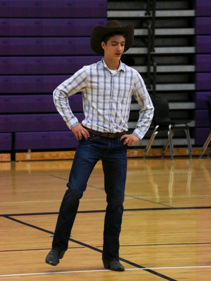 Sophomore Eli Dougan dances in the sophomore skit, on Oct. 8.